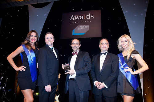 Nadeem Azam, founder and CEO of Azam Marketing, collecting the Award for Best Finance Publisher